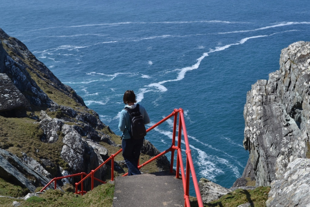 Person walking on the steps to the Sheep's Head lighthouse.